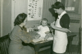 Nurse Rickard (Canadian Victorian Order) at infant welfare clinic