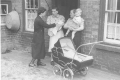 Health Visitor and young family, 1930s.