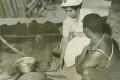 District Nurse boiling instruments in Tanganyika - 1950s