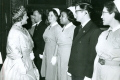 Queen Elizabeth the Queen Mother meets district nurses at St James' Palace, 1965.