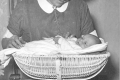 04_Weighing a baby in a wicker basket, 1932 (copyright Ian Smith)